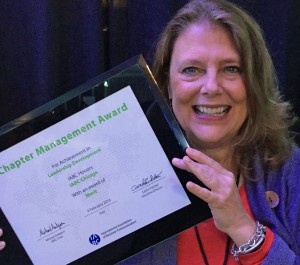 IABC/Chicago President-elect Julia Dunlop holds the award certificate at the recent IABC Leadership Institute.